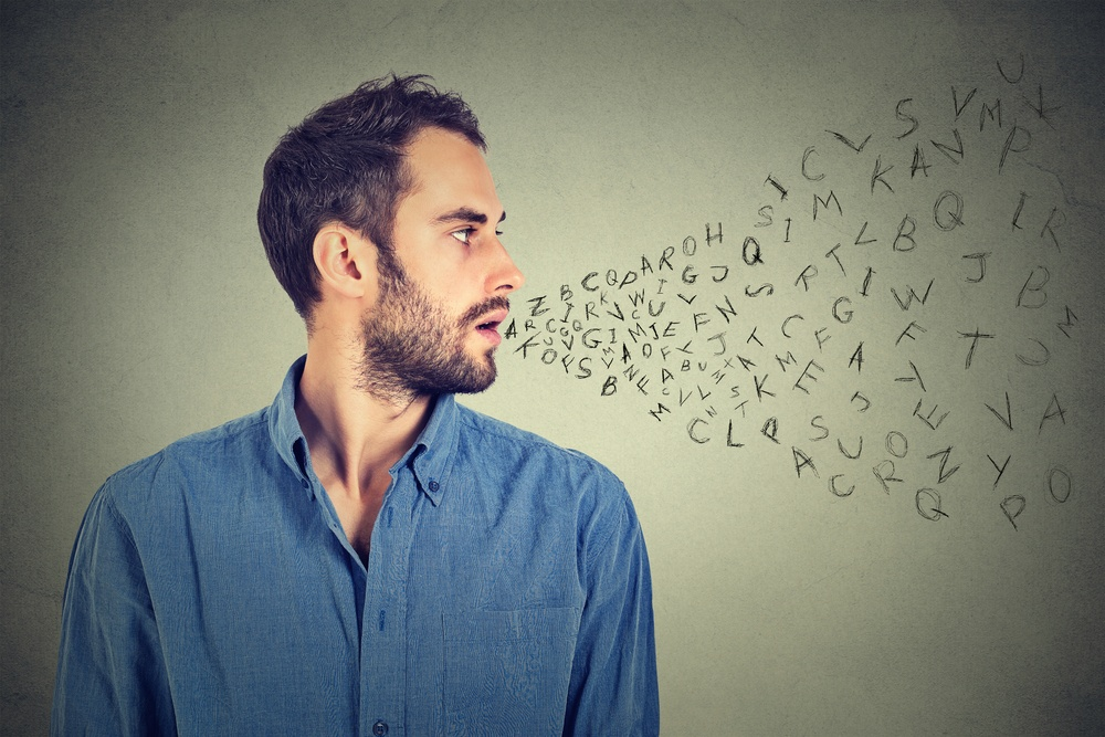 Man talking with alphabet letters coming out of his mouth. Communication, information, intelligence concept.jpeg