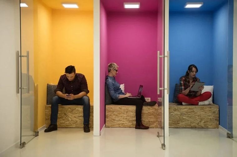 group of young business people having fun, relaxing and working in creative room space at modern startup office-1-1.jpeg